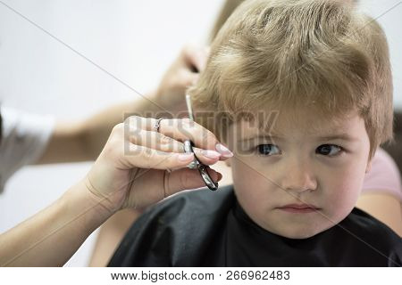 Haircut That Your Kid Will Love. Cute Boys Hairstyle. Kids Hair Salon. Little Child Given Haircut. S