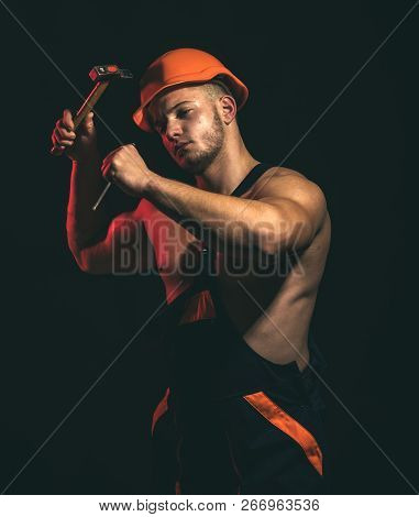 A Site Is Also Under Construction. Construction Worker Hammer A Nail. Man Work With Hammer. Hard Wor