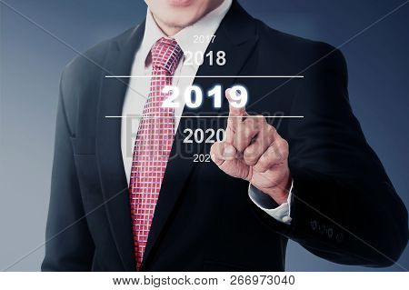 Businessman Select 2019 Number On Digital Screen. Happy New Year 2019