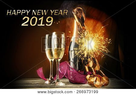 Two Champagne And Bottle With Fireworks For New Celebration. Happy New Year 2019