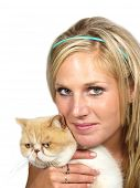 Beautiful blond girl holding a cat on white background poster
