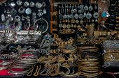 Bijoux for sale Imitation of Indian jewels at the market in Bologna, Italy. Gold and bronze necklaces, pendants and hoop earrings, earrings with colored stones, choker, pendant, brown ethnic bracelet, silver ethnic bracelet, brooches, rings, bracelet poster