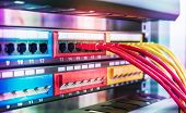 Network cables in switch and firewall in cloud computing data center server rack poster
