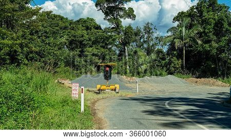 Mackay, Queensland, Australia - May 2020: Stop Go Sign At Roadworks In A National Park
