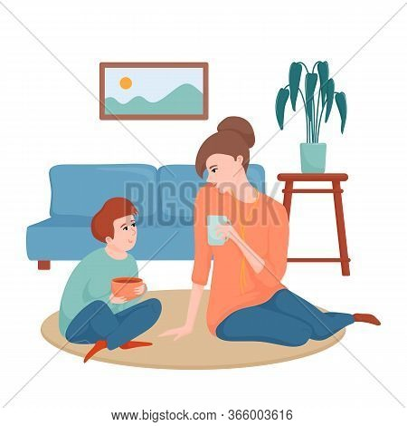 Happy Mother And Son Sitting On The Floor In The Living Room, Drinking Tea And Talking, Spending Tim