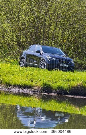 Minsk, Belarus - May 10, 2020: Renault Arcana Car Outdoors On The River