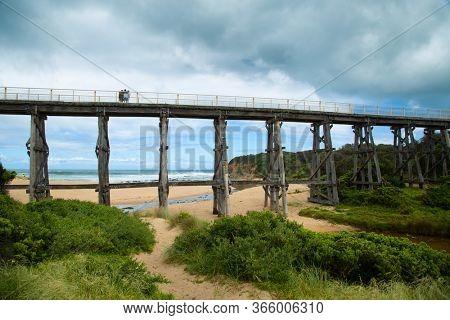 Trestle bridge in Kilcunda in Australia is 91 meter long built over the Bourne Creek with the ocean in background