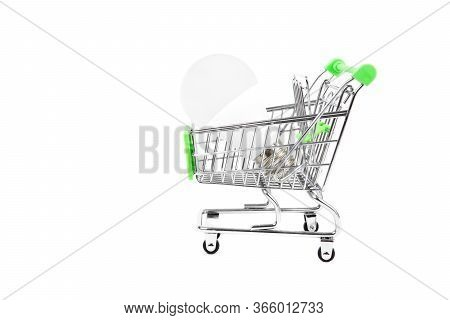 Environmentally Friendly Led Light Bulb In A Miniature Shopping Cart. Close-up Shot, Isolated On Whi