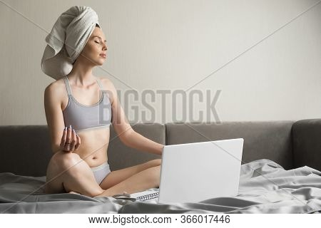 Young Calm Woman Relaxing Meditating With Laptop At Home, Meditating With Eyes Closed For Increasing