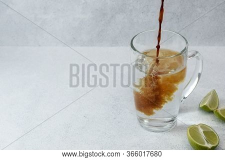 Coffee Tonic With Sliced Lime On Light Background With Copy Space. Preparation Of New Trendy Drink.