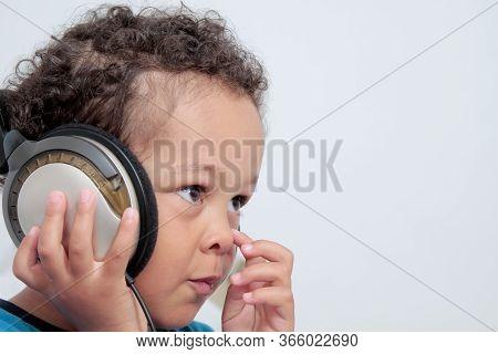 Boy With Headphones Enjoying Music   On White Background Stock Photo