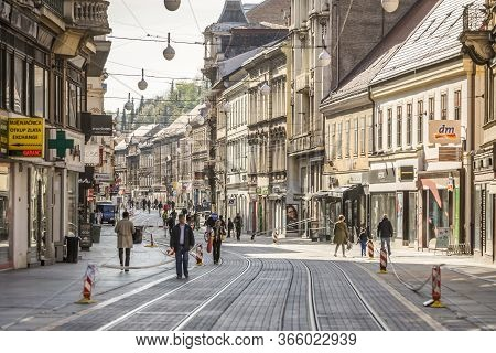Zagreb, Croatia - 15 April, 2020 : People Walking On The Ilica Street That Is Blocked With Police Ta