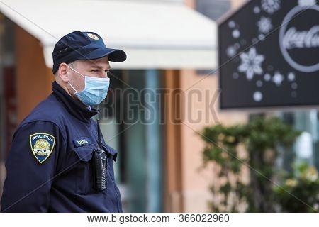 Zagreb, Croatia - 01 May, 2020 : Policeman Wears A Protective Medicine Mask Because Of Coronavirus O