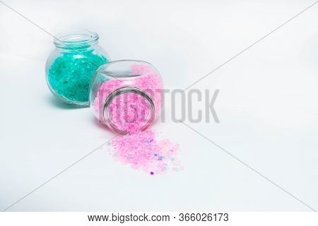 Jars With Turquoise And Light Pink Bath Salts Are On The Left Side Of The Frame. Horizontal Photo. O