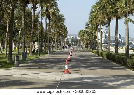 Limassol, Cyprus, May 11th, 2020: Seafront Promenade Molos With Red And White Striped Traffic Cones