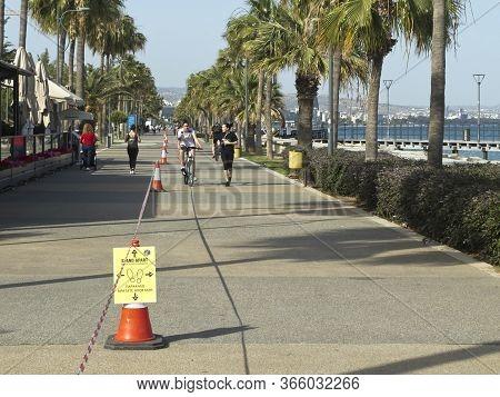 Limassol, Cyprus, May 11th, 2020: Seafront Promenade Molos During Coronavirus Quarantine With A Soci