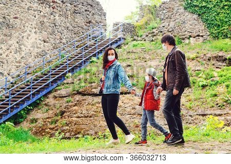 Coronavirus Quarantine. Family Trip To Old Castle. Family Walking Near Castle Ruins.