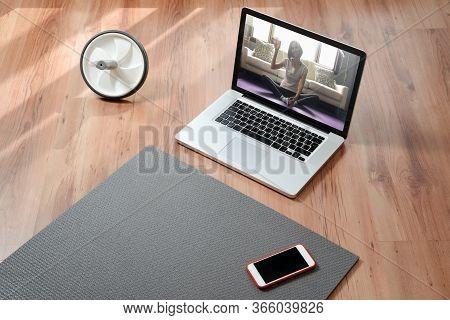 Yoga Teacher Online. Closeup Of Equipment For Online Fitness At Home: Exercise Mat, Smartphone, Lapt