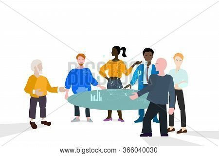 Briefing And Live Conference. Workflow , A Group Of People Stands Near A Table And Discusses The Pro