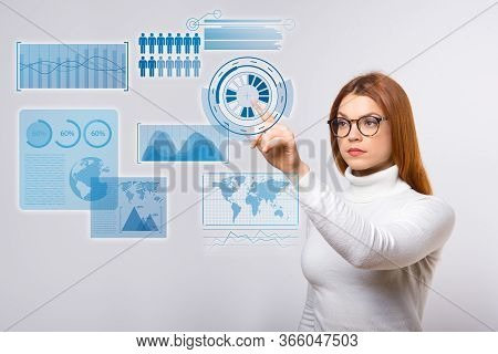 Focused Woman Pushing Virtual Statistics Graphics. Concentrated Young Woman In Eyeglasses Touching A