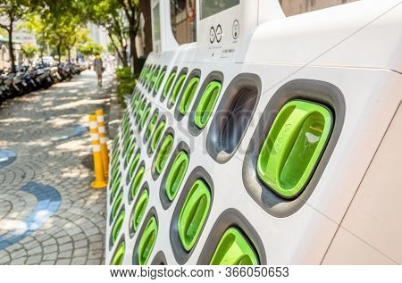 Taipei, Taiwan - August 17th, 2019: charging station for battery packs of Taiwan-based Gogoro electronic motocycle at street in Taipei, Taiwan, Asia