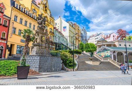 Karlovy Vary, Czech Republic, May 10, 2019: Holy Trinity Column Near Market Colonnade Trzni Kolonada