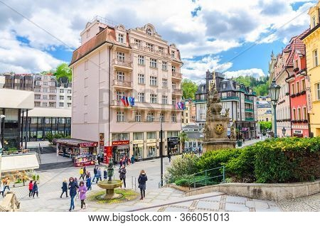 Karlovy Vary, Czech Republic, May 10, 2019: Carlsbad Historical City Centre With Holy Trinity Column