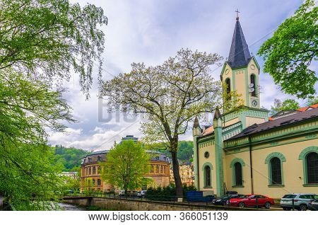 Karlovy Vary, Czech Republic, May 11, 2019: St. Peter And Paul Church And Kaiserbad Spa Imperial Bat