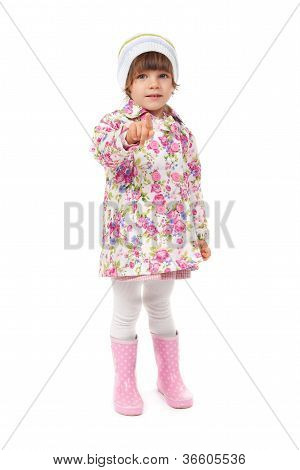 Little Girl In Boots And A Jacket Shows Finger