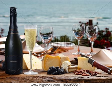 Champagne with special cheeses on the beach