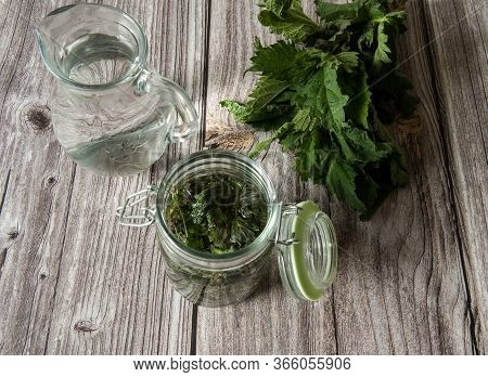 Natural Home Skin Care. Preparation Of Lotion For The Face. Leaves Of Nettle Dioecious, Vodka In A J