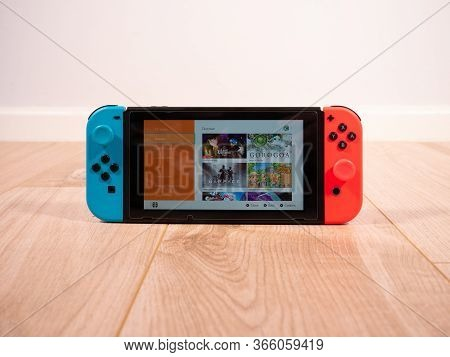 May 2020, Uk: Nintendo Switch Online E-shop Home On White Studio Background