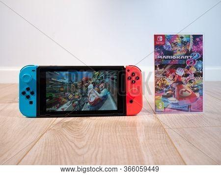May 2020, Uk: Nintendo Switch Console Mario Kart Game On White Studio