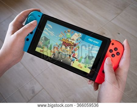 May 2020, Uk: Nintendo Switch New Moving Out Game Handheld Console At Home