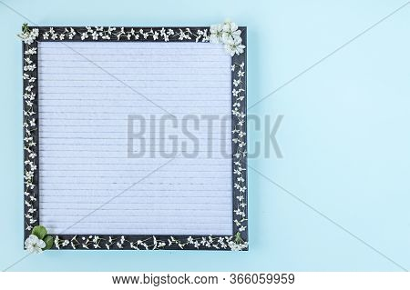 Blank Writing Board Decorated With White Small Flowers. Place For Text. Banner.