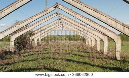 Old Abandoned Barn. Old Abandoned Concrete Structure Farm. Interior Of The Old Ruined Abandoned Barn