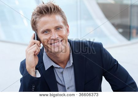 Closeup Portrait Of Handsome Business Man Using Cell Phone, Smiling