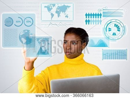 Focused Developer Holding Laptop And Touching Virtual Statistics. Concentrated Young Lady Working Wi
