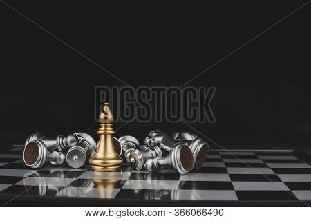 Victory. Gold Bishop Chess With Silver Chess Pawns Pieces On Chess Board Game Competition With Copy