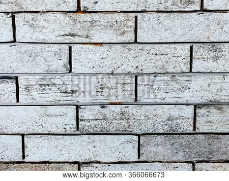 Close-up, Gray Brick Wall With Texture Brick. Contrast Stitches. Durable Masonry. Brick Background.