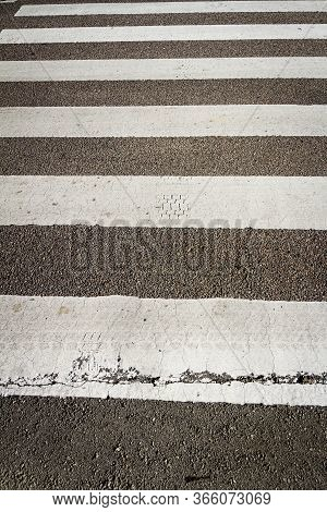 Pedestrian Zebra Crossing On Asphalt Road. Road Safety Concept.