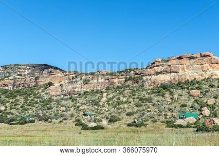 Fouriesburg, South Africa - March 18, 2020: Mountain Landscape With Chalets At Uithoek Near Fouriesb