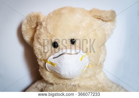 Cute Teddy Bear With Protective Medical Mask On White Background. Concept Of Pediatric Treatment, Hy