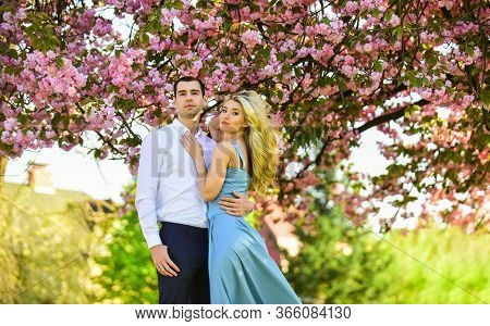 Passion Concept. Man And Woman In Blooming Garden. Couple Spend Time In Spring Tree Garden. Loving P