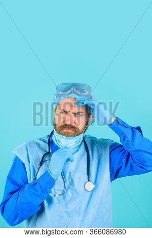 Doctor With Stethoscope. Man Doctor In Protective Suit And Medical Mask. Medical Physician Doctor Ma