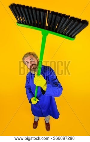 House Cleaning. Broom. Bearded Man With Broom. Cleaning And Disinfection Toilet. Professional Cleani