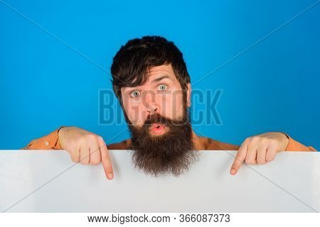 Copy Space. Advertising Board. Surprised Man With Blank Board. Space For Text. Bearded Man Holds Emp