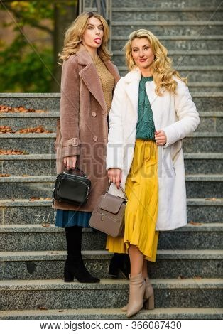 Autumn Outfit. Women Wear Stylish Outfit And Carry Purse. Outerwear Modern Warm And Stylish Eco Fur.