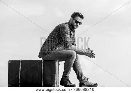 Adventure Awaits. Male Fashion Style. Looking So Trendy. Macho Man Unshaven Face Sit On Tour Bag. Bu