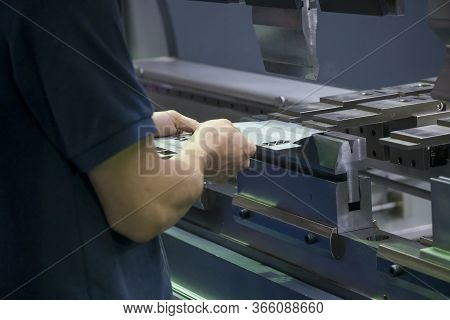 The Operation Of Hydraulic Bending Machine With Technician.  The Automotive Sheet Metal Manufacturin